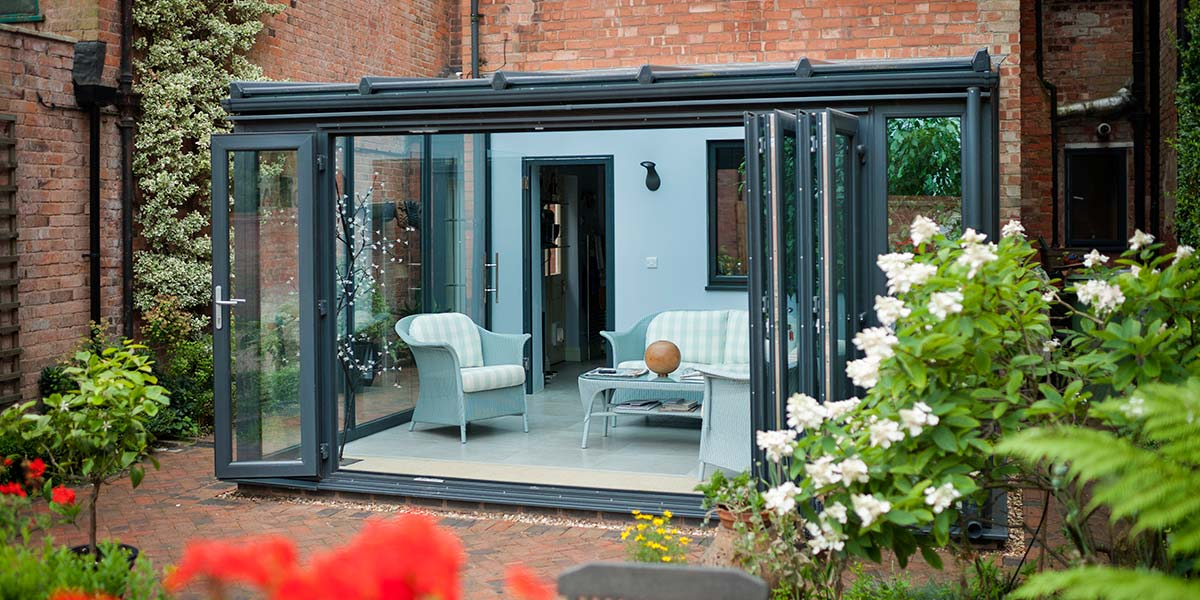 Classic Grey Lean-To Conservatory with Bi-Folding Doors from Planet
